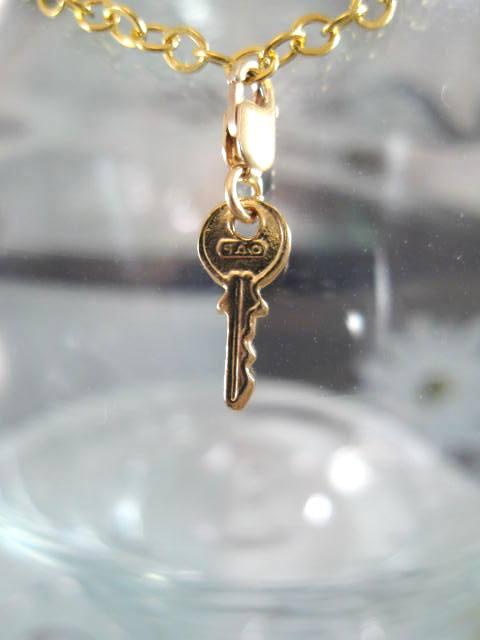 Guldberlock med karbinlås - Nyckel 2/14K GF