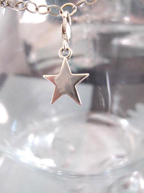 Berlock med karbinlås - Symbol/Stjärna