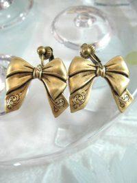 Clips örhängen med guld Rosetter